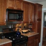 Galley kitchen redo - Maple cabinets and stainless steel backsplash